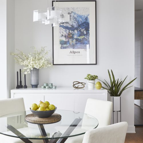 toronto condo renovation - modern scandi dining room with glass table - decorating with white - modern chandelier light fixture - wood floors - linda mazur design toronto designer - small space living