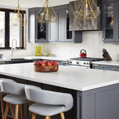toronto life - toronto home renovation - small space open concept living - dark grey kitchen cabinetry white quartz counters - gold lighting and scandi barstools - white chevron tile backsplash - linda mazur design toronto designer