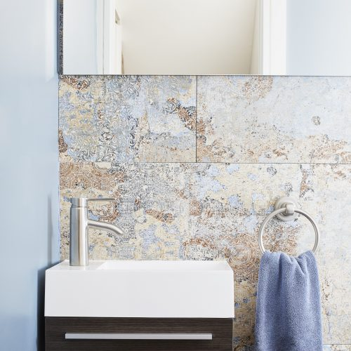 toronto annex small home - small space bathrooms - tiny wall hung vanity - blue powder room with feature wall - small space living - featured in Condo Life and Toronto Homes - linda mazur design - small space designer toronto designer