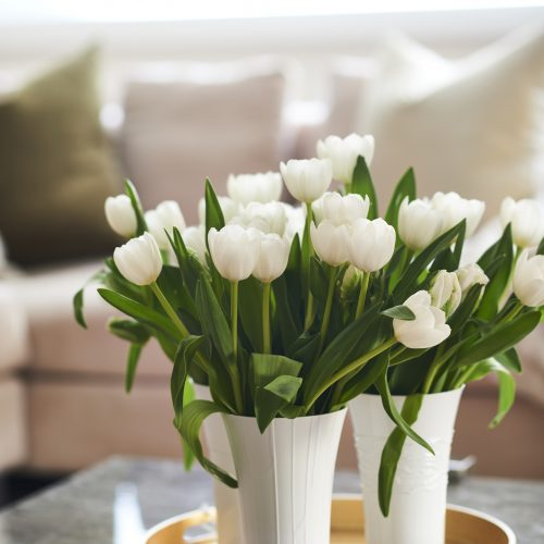 pretty coffee table display - gold tray and white tulips - linda mazur design