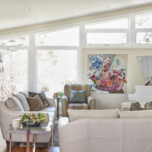 toronto mid-century home featured in toronto homes - luxury family home - living room with white piano bright art work- linda mazur design toronto designer - design build