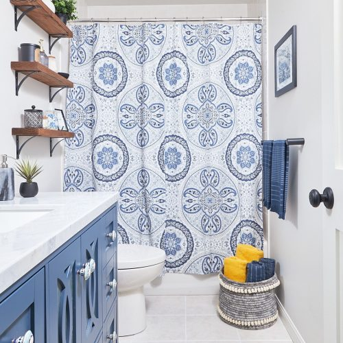 newmarket small bathroom - bathroom design - blue vanity - custom millwork - tub shower combo no glass - pretty blue bathroom with shower curtain - linda mazur design newmarket ontario - condo bathroom renovation