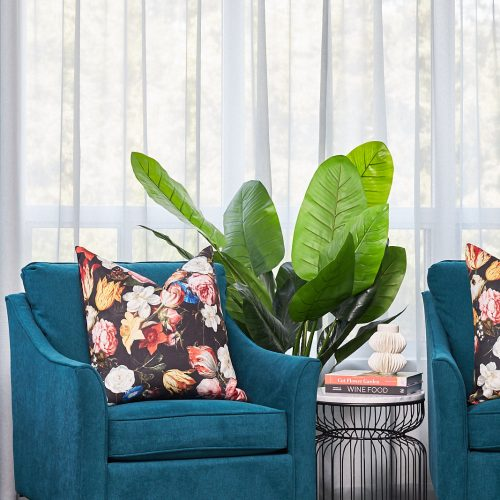 newmarket condo decorating - pretty blue chairs - floral pillows - sitting area - living room - blue sheer curtains - pattern play mixing patterns - linda mazur design