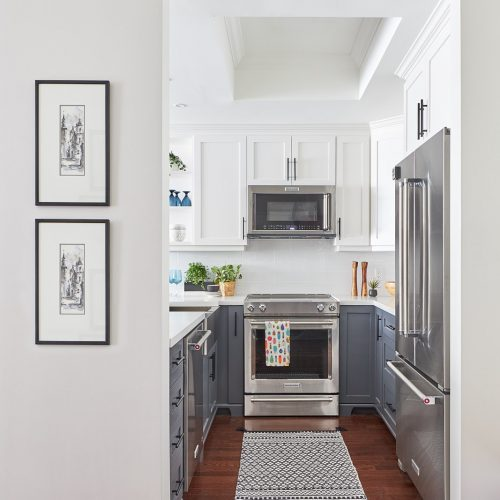 toronto condos - newmarket condo renovation - wood flooring - two colour kitchen - two color kitchen cabinetry - white and dark grey millwork - open shelving accents - microwave over slide in range - linda mazur design - newmarket design build renovate decorate