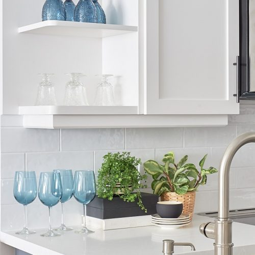 toronto condo kitchen renovation - blue accessories - open shelving display - plants add interest - decorating with plants - white counter tops and white cabinets - linda mazur design- design and decorate york region