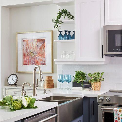 york region condo kitchen reno - apron sink white quartz counters - white and dark grey cabinets millwork - open shelving - open concept kitchen - linda mazur design