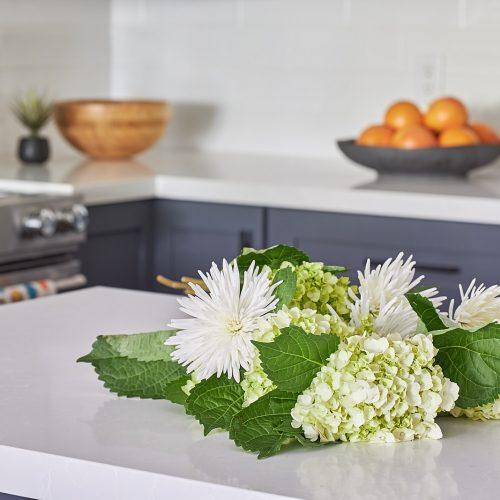 newmarket condo renovation kitchen - quartz counters - dark grey cabinetry with white subway tile backsplash - kitchen decorating - linda mazur design