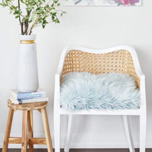 corktown condo small space living - renovations - rattan accent chair with mohair blue cushion CB2 - bright artwork - linda mazur design