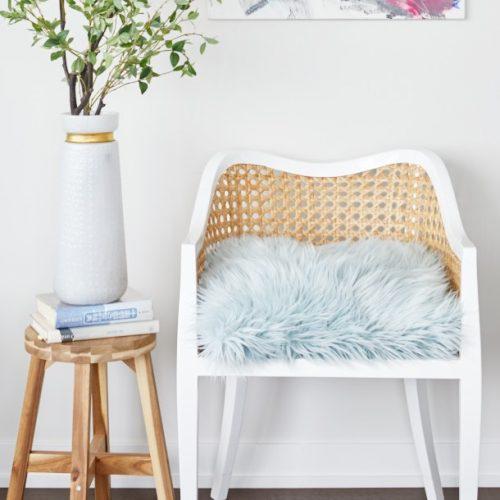 corktown condo small space living - renovations - rattan accent chair with mohair blue cushion CB2 - bright artwork - linda mazur design