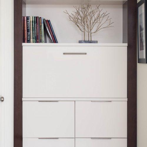 newmarket midcentury home custom millwork - extra hallway storage concealed charging station - white cabinetry linda mazur design york region designer