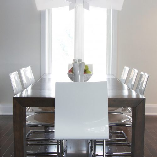 modern dining room with wood table - cantilever white dining chairs and modern white chandelier - linda mazur design toronto designer