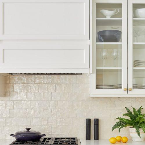 markham kitchen renovation cream custom millwork with square mallorca tile backsplash and glass cabinetry - custom range hood - luxury kitchen - family home - linda mazur design