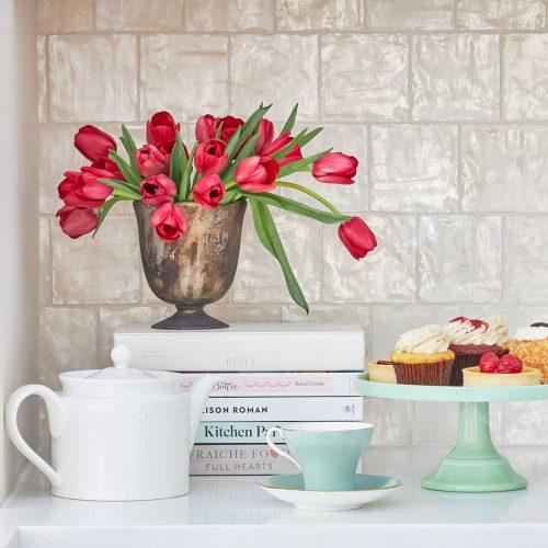 markham luxury kitchen renovation - cream white backsplash - pretty floral and tea display on quartz white countertops - linda mazur design