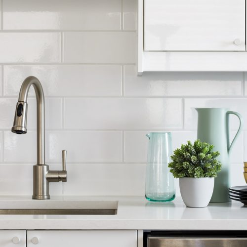 toronto condo renovation - scandi kitchen white and wood cabinetry with white quartz counter tops - wood floors and white subway tile backsplash - small space living - open concept living - toronto designer Linda mazur design