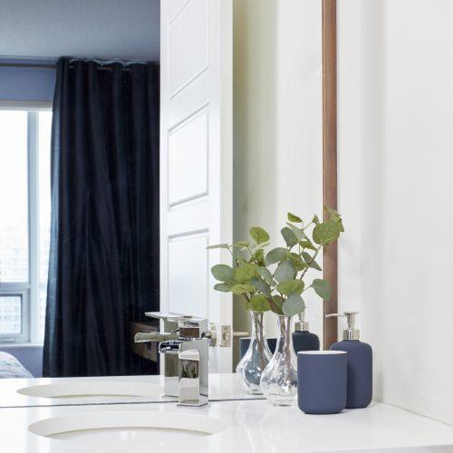 toronto condo small space living - bathroom renovation custom walnut cabinet with quartz counter - offset sink for additional counter space - small space design - linda mazur design