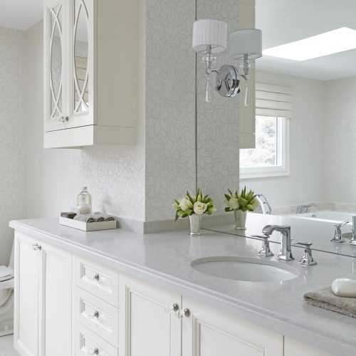 king city master ensuite bathroom - custom millwork - white and grey bathroom quartz counter top single sink large vanity with large mirror and wall sconces - linda mazur design toronto designer
