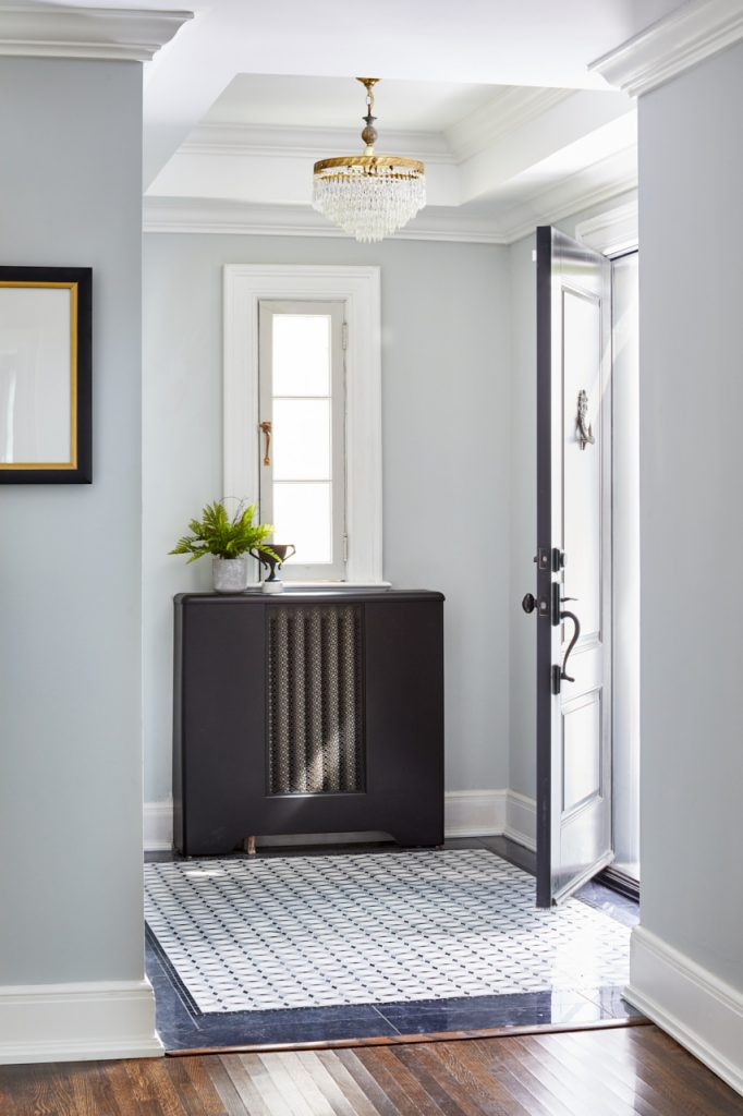 toronto historic home entrance - luxury family home -black front door - custom marble tile inlay floor - foyer -wood floors and marble tile combination - vaulted ceiling - tray ceiling - ceiling details- linda mazur design- toronto designer