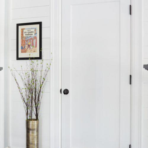 toronto family home - shiplap wall paneling - black and white spaces - black door hardware - wood flooring - linda mazur design toronto designer
