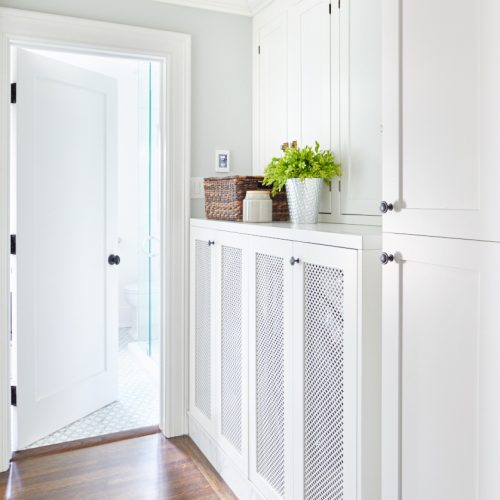 small space laundry - built in concealed laundry area - mesh door fronts - historic home - custom cabinetry - white cabinetry - linda mazur design - toronto designer - luxury family home - second floor laundry space