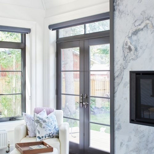 historic home - garage converted to four-seasons sunroom - custom marble modern fireplace - transitional glass french doors - vaulted ceiling - shiplap ceiling - custom millwork - blue marble fireplace surround - linda mazur design - toronto designer