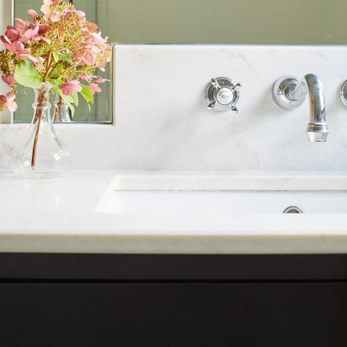 custom millwork quartz countertop with wall mount faucets, wall hung vanity, historic toronto homes - family home luxury living linda mazur design toronto design build renovate