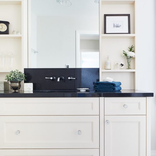 black and cream master ensuite - newmarket homes - black quartz counters with wall mount faucets - custom vanity millwork - cement tile floor - patterned floor - linda mazur design toronto designer - small space challenges
