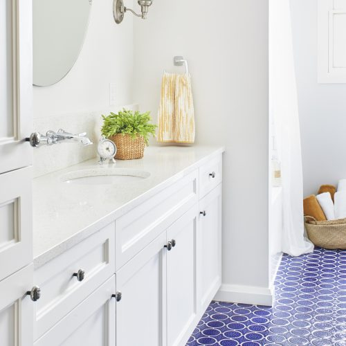 newmarket bathroom renovation - bright blue patterned floor tiles - white custom cabinetry - quartz counters - boho vibe - linda mazur design toronto designer
