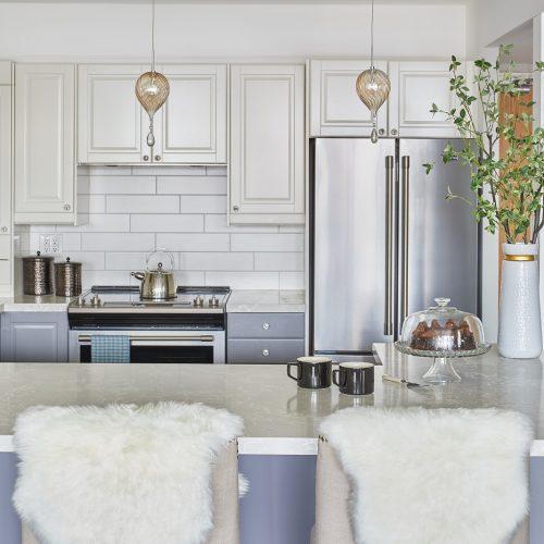 toronto condo kitchen renovation - white and blue grey custom cabinetry with wood floor quartz countertop - white tile backsplash - linda mazur design newmarket ontario
