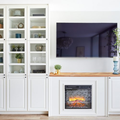 toronto condo renovation - fireplace and custom white cabinetry millwork - fireplace and tv wall - electric fireplace - wood mantel- linda mazur design newmarket ontario
