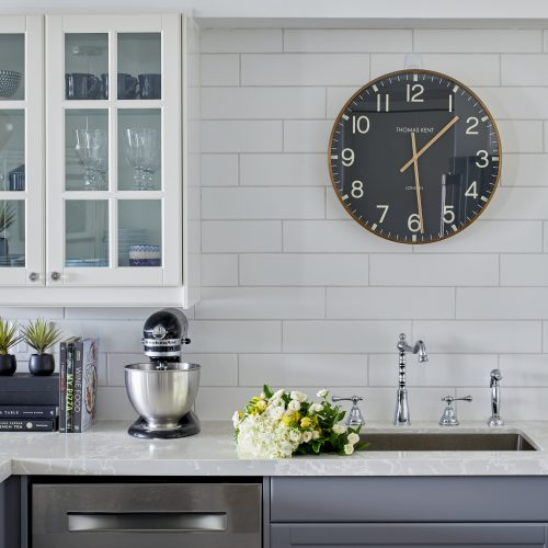 toronto condo kitchen renovation - white and grey cabinetry with glass cabinet and quartz countertop - white backsplash - linda mazur design