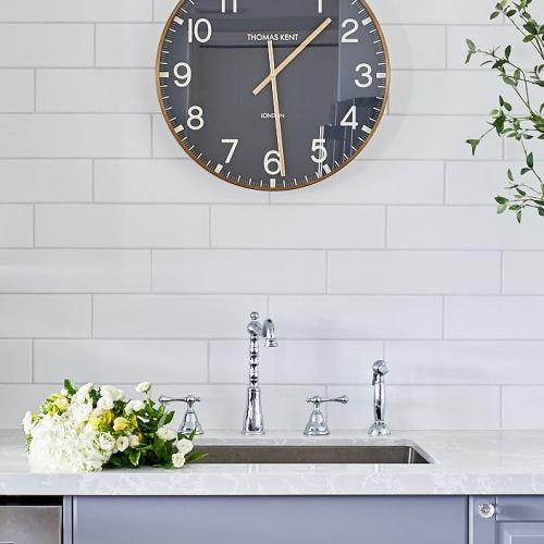 condo kitchen renovation - no upper cabinets white tiled wall