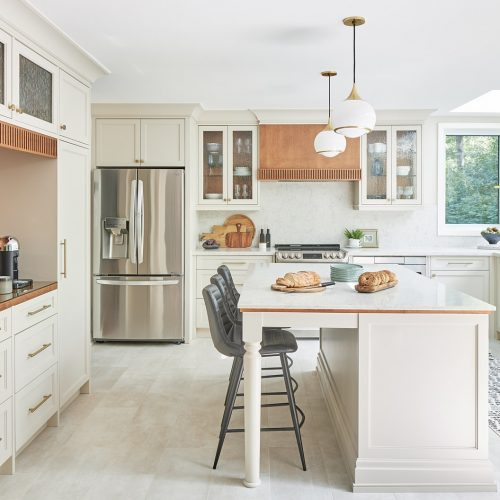 mississauga custom kitchen renovation - coffee station and pantry area - wood cabinetry and glass door front - toronto designer linda mazur design - kitchen island with quartz counters - transitional kitchen