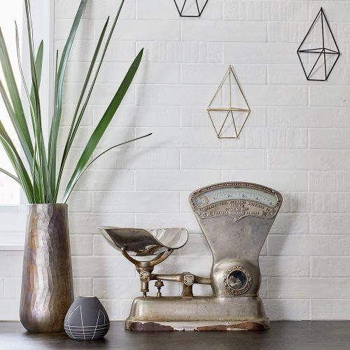 vintage inspiration - antique scale kitchen decor - white brick backsplash - dekton radium countertops black cabinets - linda mazur design toronto designer small space living