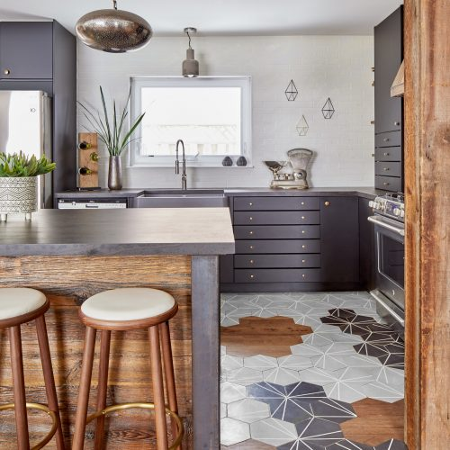 whitby kitchen renovation - small space family home - dekton countertops - cosentino - cement tile and wood floor - organic flooring pattern - black kitchen cabinets barnboard range hood - linda mazur design toronto designer- custom rustic modern kitchen - reclaimed wood kitchen island - blanco silgranit ikon sink - white brick backsplash