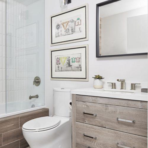 condo bathroom renovation, rustic bathroom, wood vanity, mosaic floor tile, tub and shower combo, toronto condos, toronto designer linda mazur design