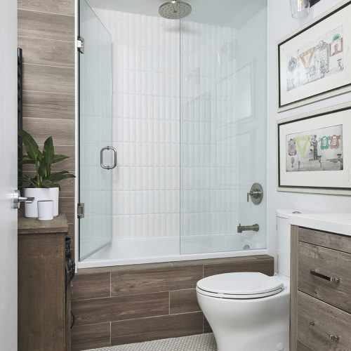 condo bathroom renovation, rustic bathroom, wood vanity, mosaic floor tile, tub and shower combo, toronto condos, toronto designer linda mazur design