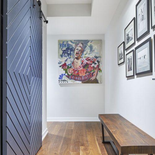 toronto condo, condo renovations, toronto designer, entrance way, foyer, custom barn doors, artwork, walnut flooring, linda mazur design