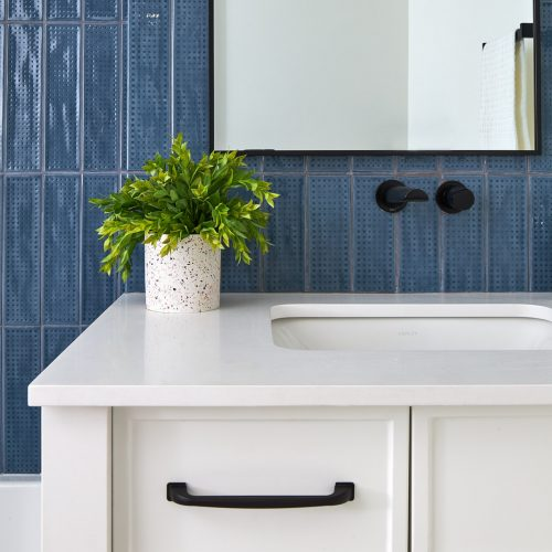 toronto condo renovations, bathroom reno, custom, blue tile, white cabinetry, wall mount faucet, black accessories, tub and shower combo, penny tile floor, toronto designer, linda mazur design